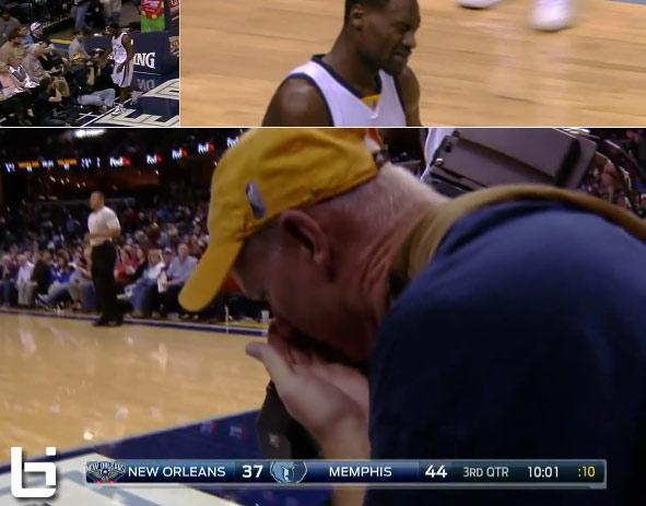 A frustrated Tony Allen smacks a cameraman's camera