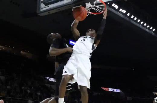 Providence's Kriss Dunn dunks on a defender