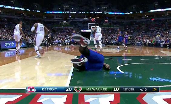 Drummond blocks Jabari Parker, catches an oop, falls, gets up & falls again!
