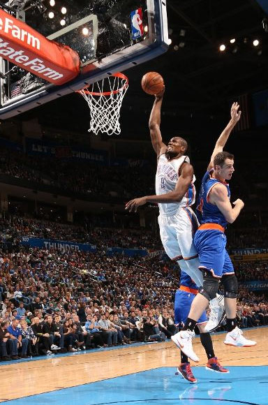 Jason Smith wisely avoids getting dunked on by Serge Ibaka