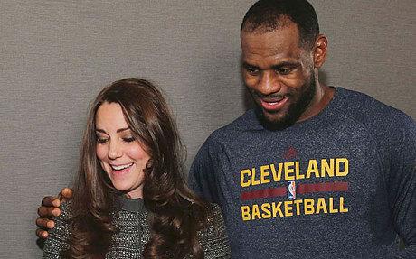 King James breaks royal protocol by putting his arm around Kate Middleton