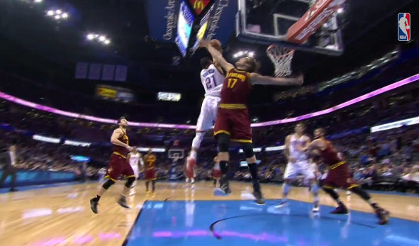 Andre Roberson changes hands in mid-air and dunks on Anderson Varejao