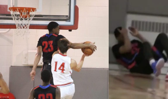 HS Sophomore D.J. Harvey smacks his head on the backboard after blocking a shot