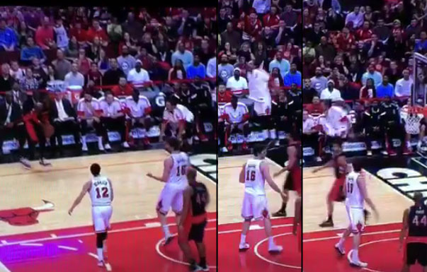 Joakim Noah tries to play defense on Terrence Ross from the bench