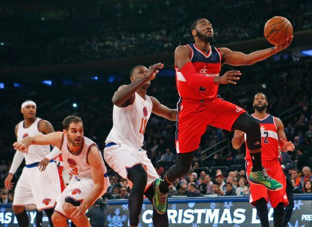 John Wall's Christmas: a 360 layup, a fight with Acy & a touching half-time feature