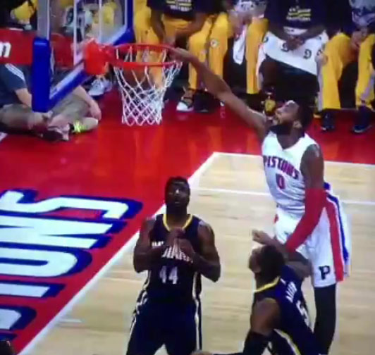 Andre Drummond catches an oop over Lavoy Allen