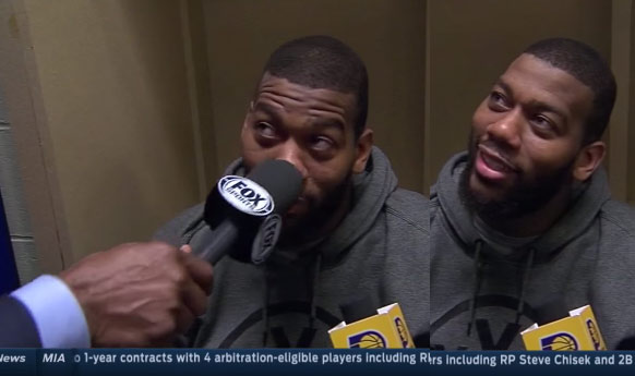 Reporter pokes Greg Monroe in the nose with a mic
