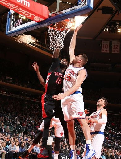 Cole Aldrich ends up on the ground trying to block a monster dunk by Amir Johnson