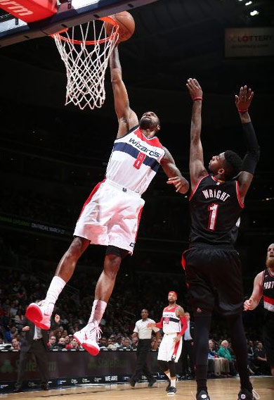 Rasual Butler throws down a dunk past Dorell Wright