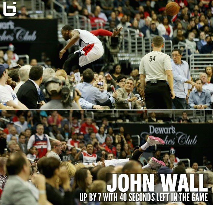 John Wall is willing to dive into the crowd to save a possession, up by 7 with 40 seconds left