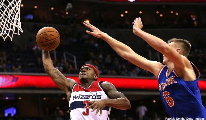 """Bradley Beal Gives 7'3 Rookie Kristaps Porzingis His First """"Dunked On"""" Moment"""