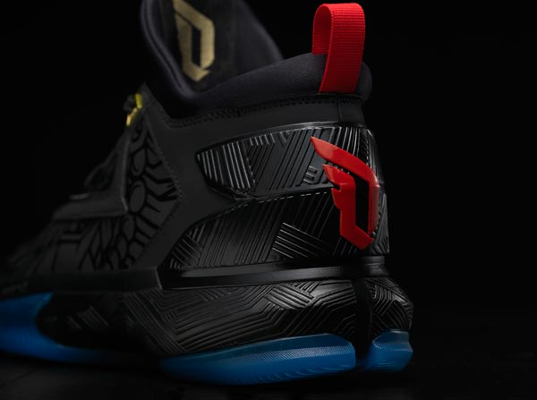 ec97112198ba The D Lillard 2 features a fanged fire monkey graphic print treated with a  gloss finish. Designed with an all-black upper